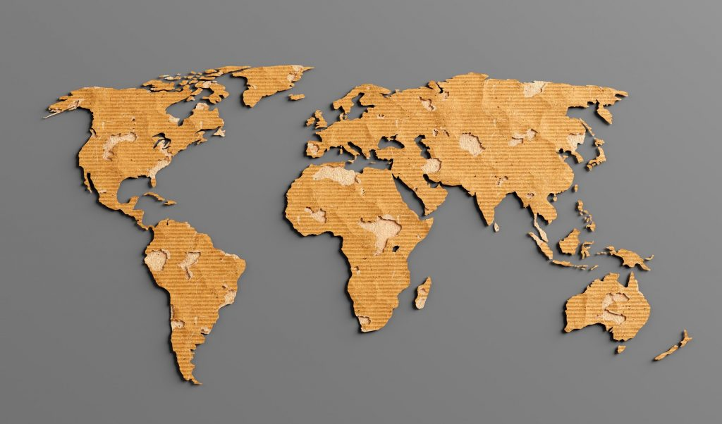 World map made of recycled cardboard paper.